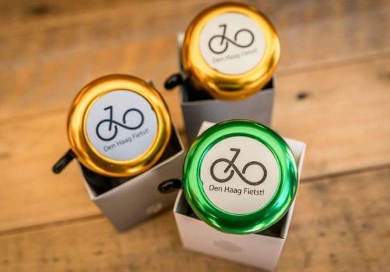 Fietsbel met logo Den Haag fietst